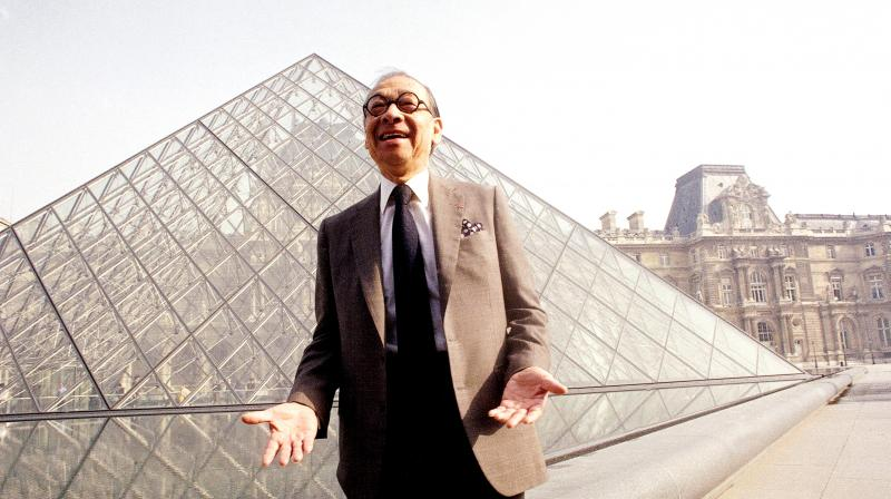 Chinese-American architect I M Pei posing for a portrait in front of the Louvre glass pyramid, which he designed, in the museum's Napoleon Courtyard, prior to its inauguration in Paris. (Photo: AP)