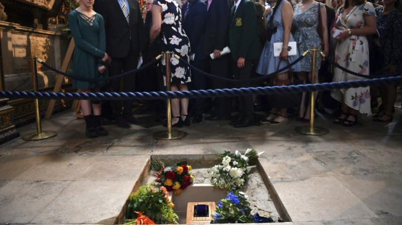 The ashes of Professor Stephen Hawking are laid to rest during his memorial service at Westminster Abbey in London, Friday June 15, 2018. (Ben Stansall/PA via AP)