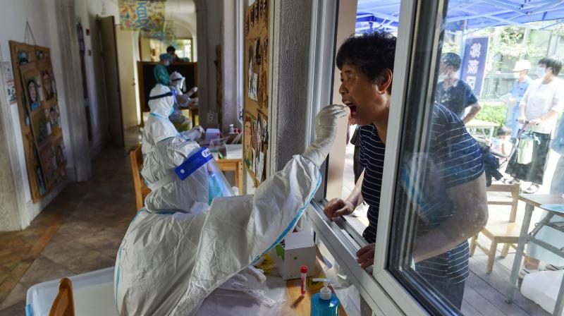 A resident receives a nucleic acid test for the Covid-19 coronavirus in Nanjing in China's eastern Jiangsu province. (Photo: AFP)