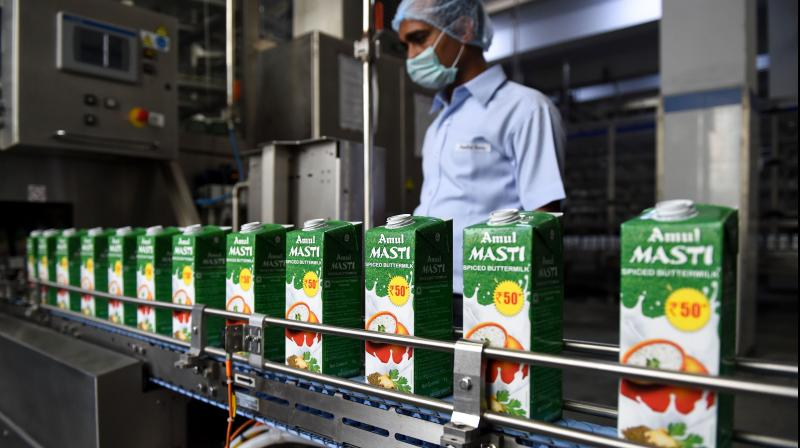 Amul to invest Rs 1,500 cr in 2 yrs to set up dairy, edible oil, bakery, potato processing plants. (AFP Photo)