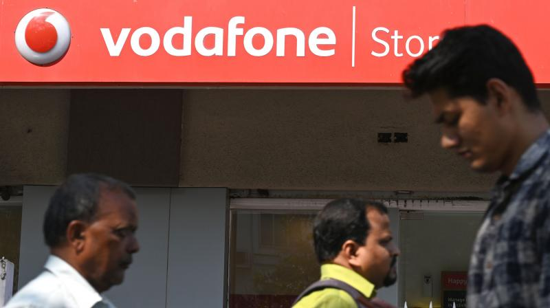 Vodafone Idea rebrands in fight for India's telecom market share. (AFP Photo)