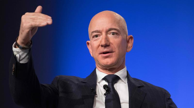 Amazon and Blue Origin founder Jeff Bezos tops Forbes richest list. (AFP Photo)