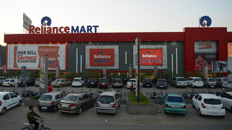 Reliance Retail runs more than 10,000 stores selling apparel, groceries and electronics across India. (AFP Photo)