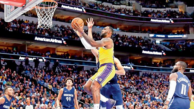 RISING ABOVE THE REST: LeBron James of Los Angeles Lakers. AP Photo