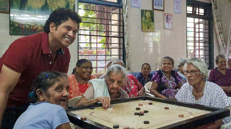 Sachin Tendulkar interacts with inmates of St Anthony's Old Age Home for Women, in Mumbai. PTI Photo