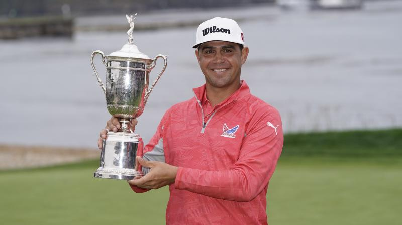 Last year's US Open winner Gary Woodland with the trophy. AP Photo