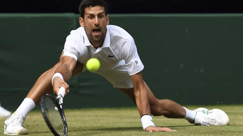 REACHING OUT: Novak Djokovic of Serbia. AP Photo