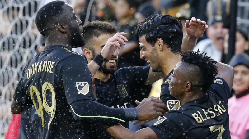 Los Angeles FC forward Carlos Vela (2nd R) of Mexico celebrates his goal with teammates in an MLS match against Portland Timbers in Los Angeles. AP Photo