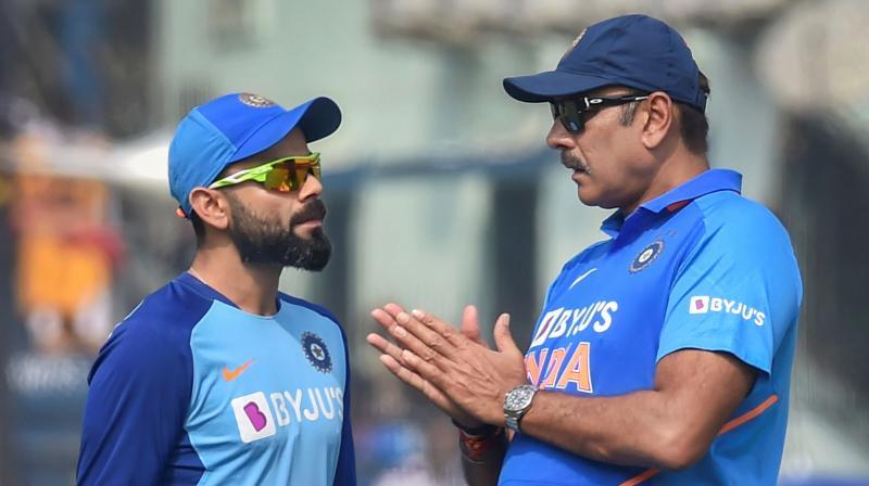 Team India coach Ravi Shastri with skipper Virat Kohli. PTI Photo