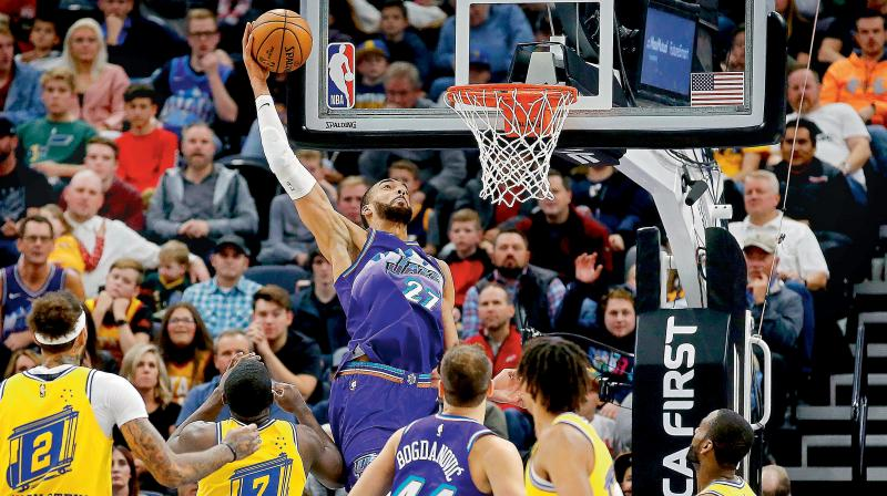 Utah Jazz center Rudy Gobert (27) scores against the Golden State Warriors. AP Photo