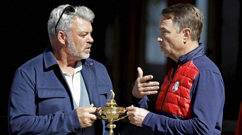 United States captain Davis Love III (R) and Europe captain Darren Clarke with the Ryder Cup in 2016. AP Photo