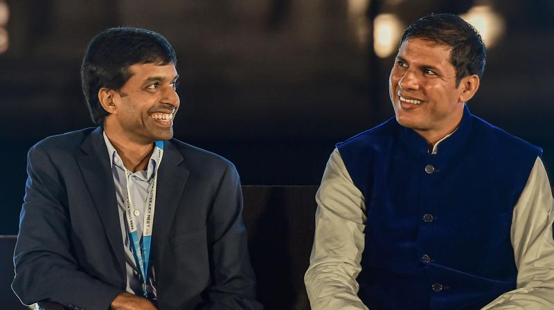 Badminton coach Pullela Gopichand (L) and Paralympian Devendra Jhajharia. PTI Photo