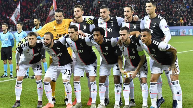 Juventus players pose before the start of a game. AP Photo