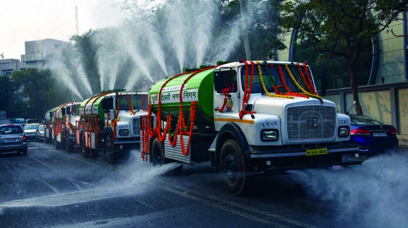 Water spraying tankers to curb air pollution launched by MPs Manoj Tiwari and Gautam Gambhir in New Delhi on Wednesday. (Photo: PTI)