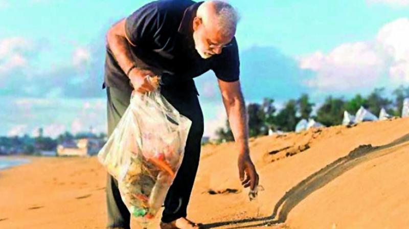 Prime Minister Narendra Modi plogging at the Mamallapuram beach.