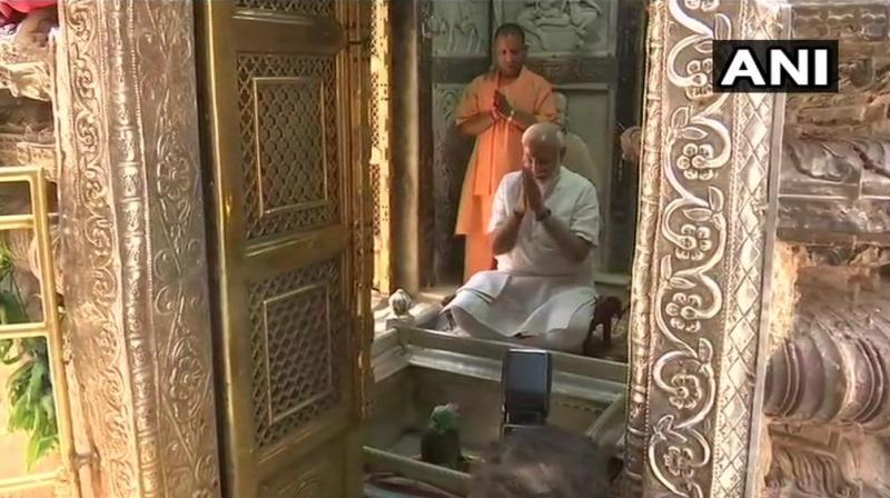 On Sunday, Uttar Pradesh Chief Minister Yogi Adityanath held a meeting with local administration officials in Varanasi to assess preparations made ahead of Modi's visit here. (Photo: ANI)