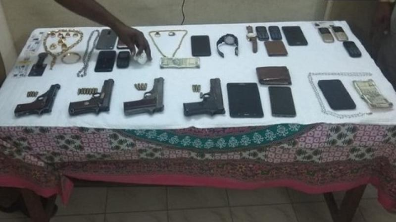 The police have registered a case and recovered pistols, phones and cash from the occupants of the car. (Photo: ANI)