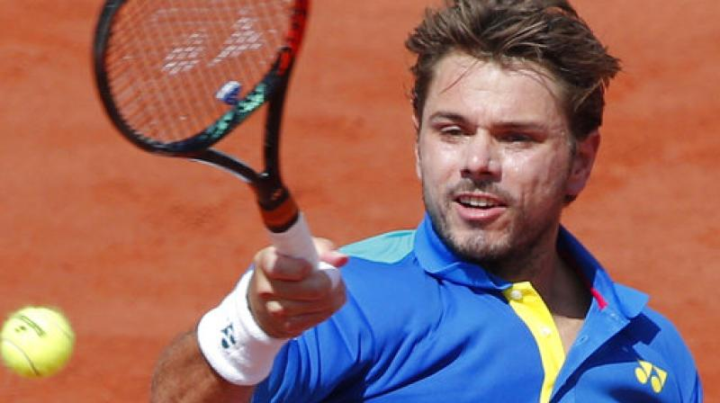 Switzerland's Stan Wawrinka plays a shot against Spain's Rafael Nadal during their men's final match of the French Open (Photo: AP)