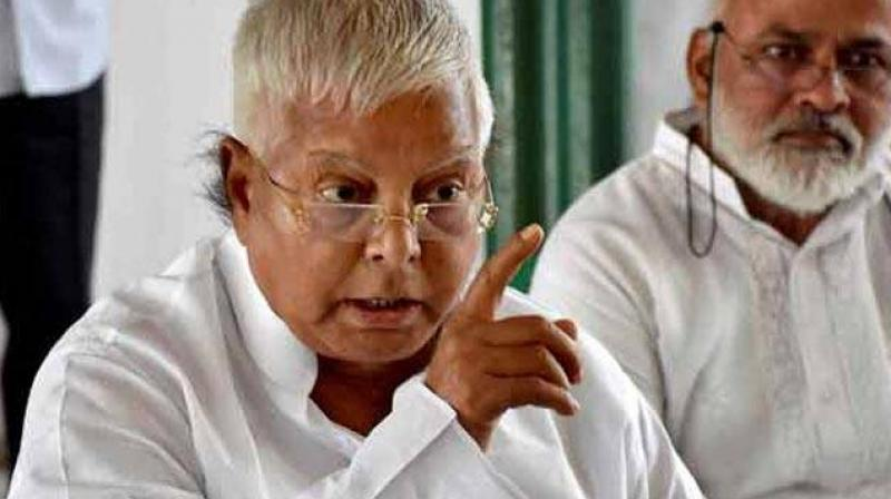 The CBI is conducting raids at the residences of former railway minister Lalu Yadav and his family members (Photo: PTI)
