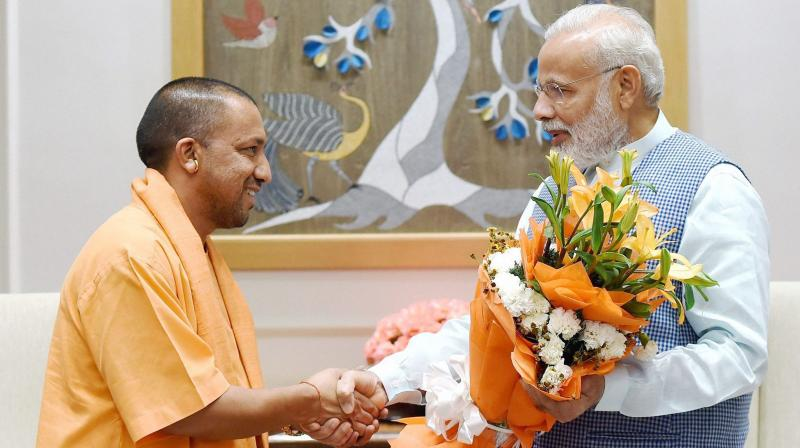 Prime Minister Narendra Modi with Chief Minister of Uttar Pradesh Yogi Adityanath during their meeting in New Delhi. (Photo: PTI)