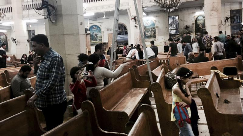 People look at damage inside the St. George's after a suicide bombing, in the Nile Delta town of Tanta, Egypt. (Photo: AP)
