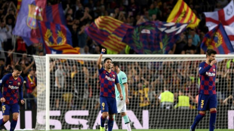 Luis Suarez scored two classy goals to inspire Barcelona to a 2-1 comeback win over Inter Milan in the Champions League on Wednesday and inflict a first defeat on Antonio Conte since he took charge of the Italians. (Photo:AFP)