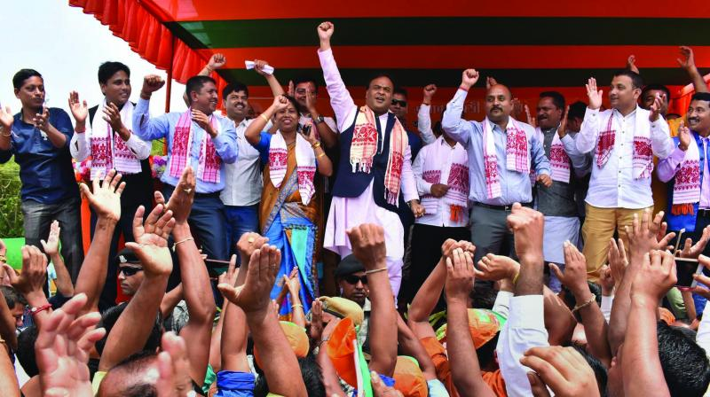 BJP leader Himanta Biswa Sarmah dances with the crowd during an election campaign rally at Bahjani in Nalbari district of Assam on Tuesday in support of the party candidate Dilip Saikia of Mangaldoi parliamentary constituency. (Photo: PTI)