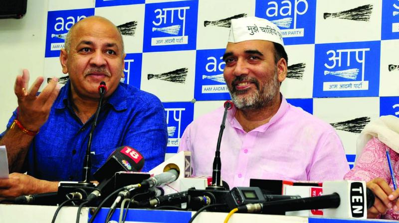 Deputy CM Manish Sisodia, minister Gopal Rai and AAP East Delhi candidate Atishi at a press conference on Tuesday. (Photo: BUNNY SMITH)