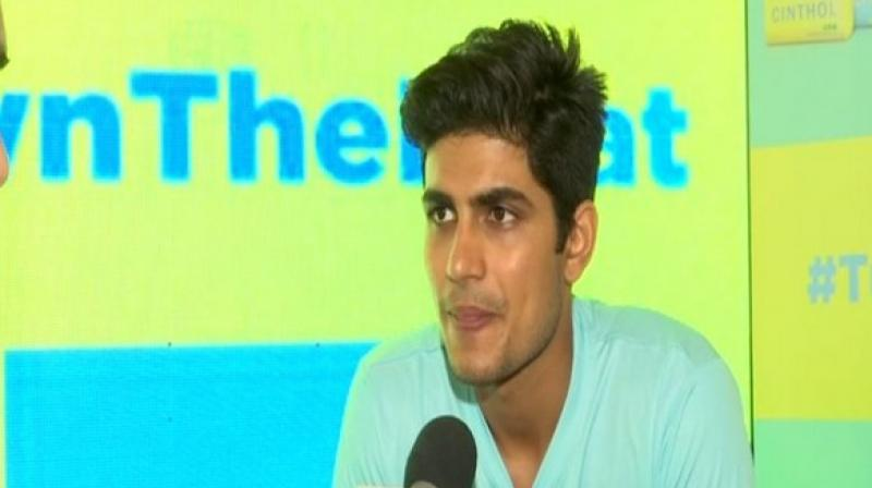 Indian batsman Shubman Gill on Wednesday said that it would be interesting to see how pink ball behaves under lights in India's first-ever day/night Test slated to be played later this month. (Photo:ANI)