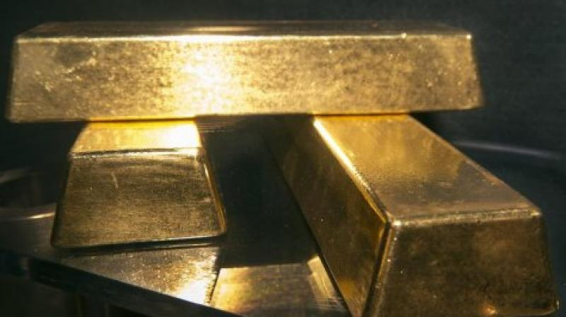 Globally, spot gold was trading higher at USD 1,337 per ounce in New York amid escalation of trade war tension between the US and China. (Representational Image | AFP)