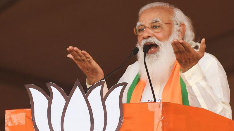 PM Narendra Modi addresses supporters of the Bharatiya Janata Party (BJP) during a mass rally ahead of the state legislative assembly elections at the Brigade Parade ground in Kolkata. (Photo: AFP)