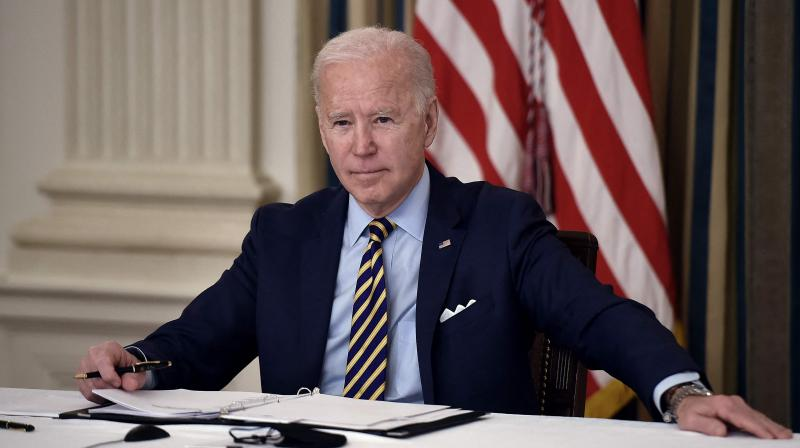 Mr Biden can do even more to help the world rid itself of the pandemic. (Photo: AFP)
