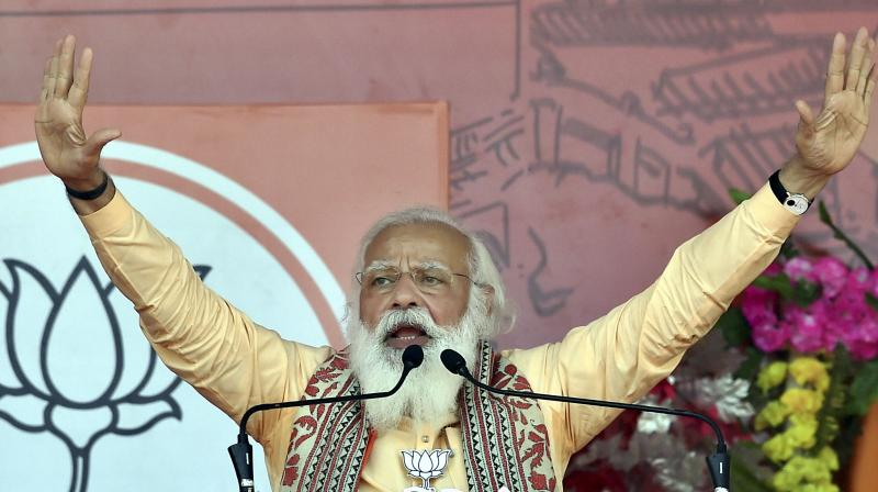 Prime Minister Narendra Modi addresses an election campaign rally in support of his party candidates, during the ongoing West Bengal assembly polls, at Joynagar in South 24 Parganas district. (Photo: PTI)