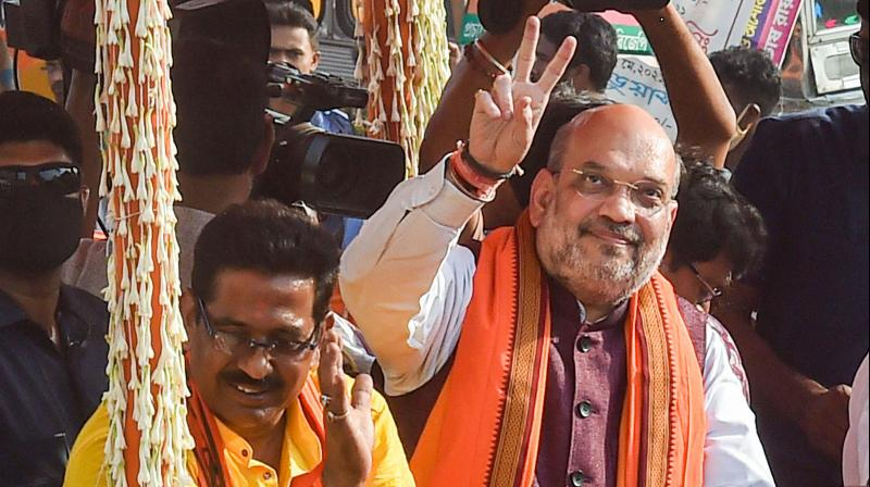 Union Home Minister Amit Shah during a roadshow in support of BJP candidates ahead of the third phase of West Bengal Assembly polls, at Baruipur Paschim in South 24 Parganas. (Photo: PTI)