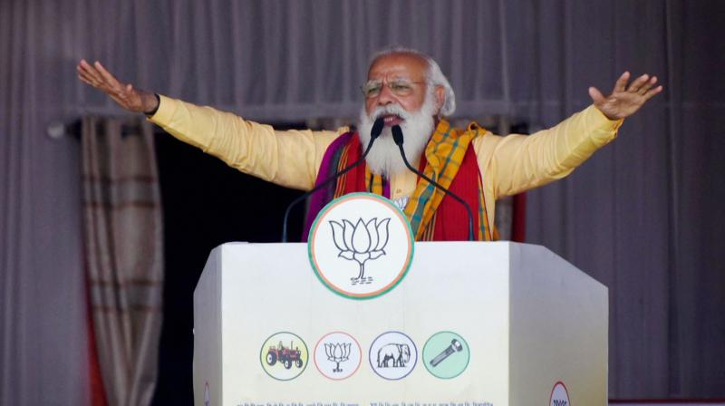 Prime Minister Narendra Modi addresses an election campaign rally in support of BJP alliance party candidates of United People Party Liberal (UPPL) ahead of the third phase of Assam Assembly Elections, at Laupara in Baksa district. (Photo: PTI)