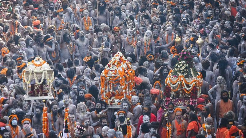 Devotees gather to offer prayers during the third 'Shahi Snan' of the Kumbh Mela 2021, at Har ki Pauri Ghat in Haridwar. (Photo: PTI)