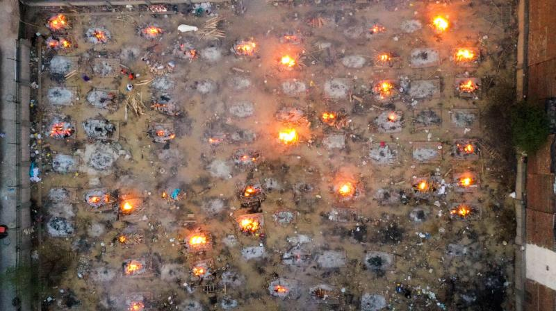 Burning pyres of victims who lost their lives due to the Covid-19 coronavirus are seen at a cremation ground in New Delhi. (Photo: AFP)