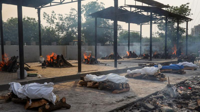 Victims of Covid-19 being cremated at Dwarka cremation ground in New Delhi, Friday, April 30, 2021. (PTI Photo)
