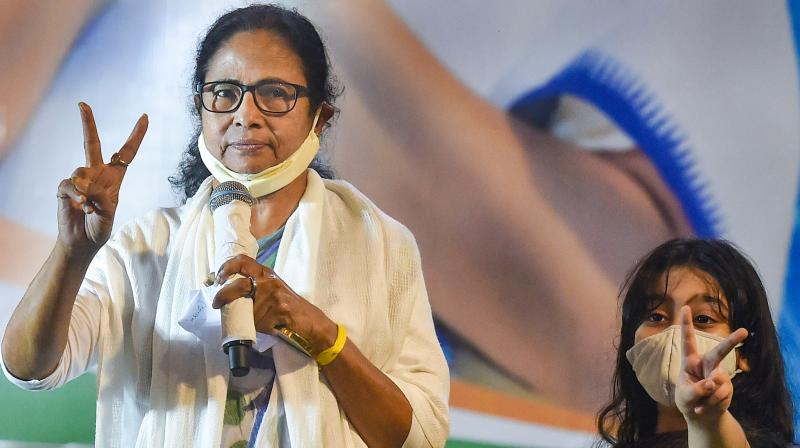 TMC chief Mamata Banerjee with her nephew Abhisekh Banerjee's daughter Azania (R), during interaction with media after trends show her party's wins in the State Assembly Election 2021, in Kolkata. (Photo: PTI)