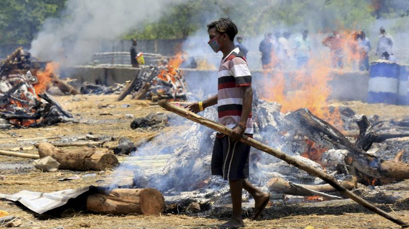 Mass cremation of COVID-19 victims at Parwati Ghat as coronavirus cases surge in Jamshedpur, Monday, May 10, 2021. (PTI Photo)
