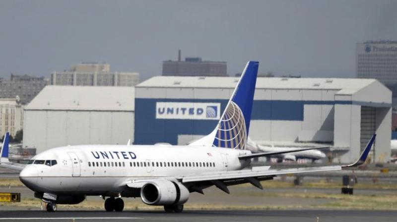 United Airlines is preparing to furlough 16,370 workers when federal aid expires on October 1. (AFP Photo)
