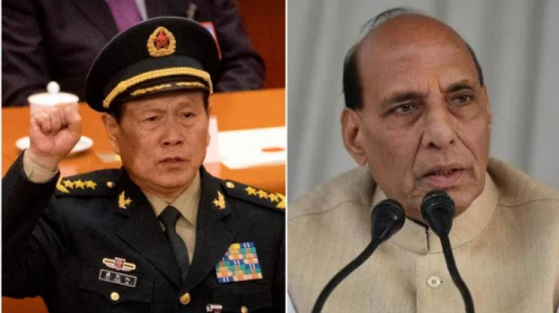 Chinese Defence Minister General Wei Fenghe (L) and Indian Defence Minister Rajnath Singh (R). (Photo- PTI/Twitter)