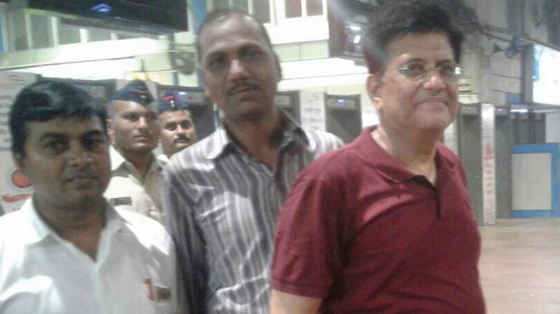 Union railway minister Piyush Goyal (right) at Churchgate station with WR staff on Saturday.