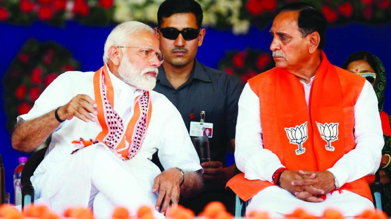 PM Narendra Modi with Gujarat CM Vijay Rupani at an election rally in Junagadh on Wednesday. (Photo: PTI)