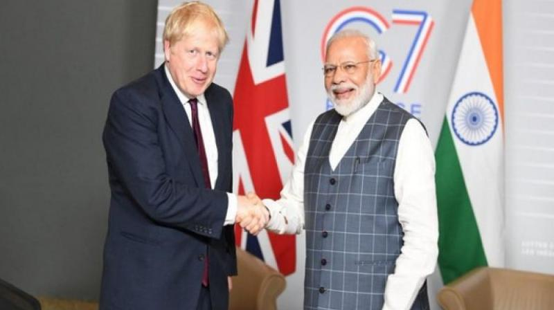 British Prime Minister Boris Johnson Prime Minister Narendra Modi (Photo: ANI)