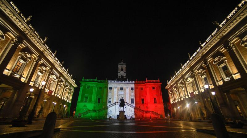 The colors of the Italian flag are projected onto the Palazzo Senatorio building on Capitoline Hill (Campidoglio) in Rome on March 17, 2020, as a