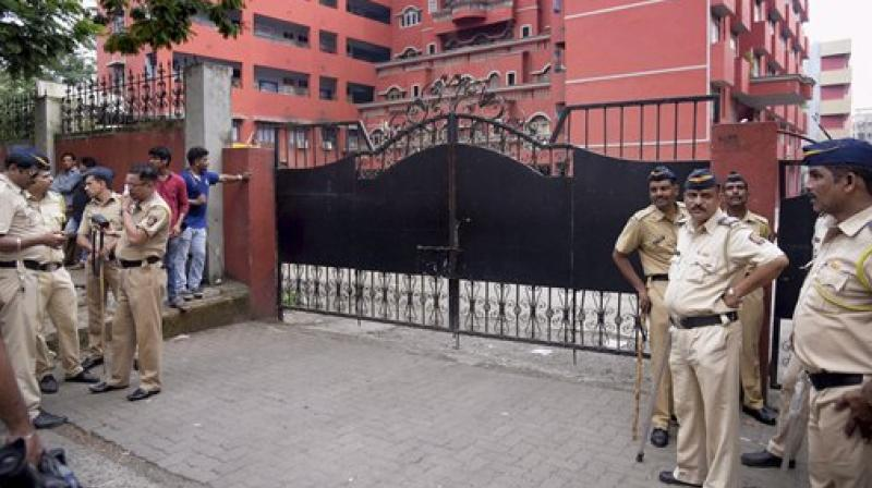 Police personnel deployed outside the Ryan School at Kandivali in Mumbai. (Photo: PTI)