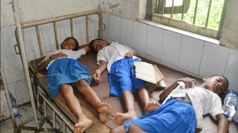 Schoolgirls share a bed at a primary health centre in rural India. (AFP)