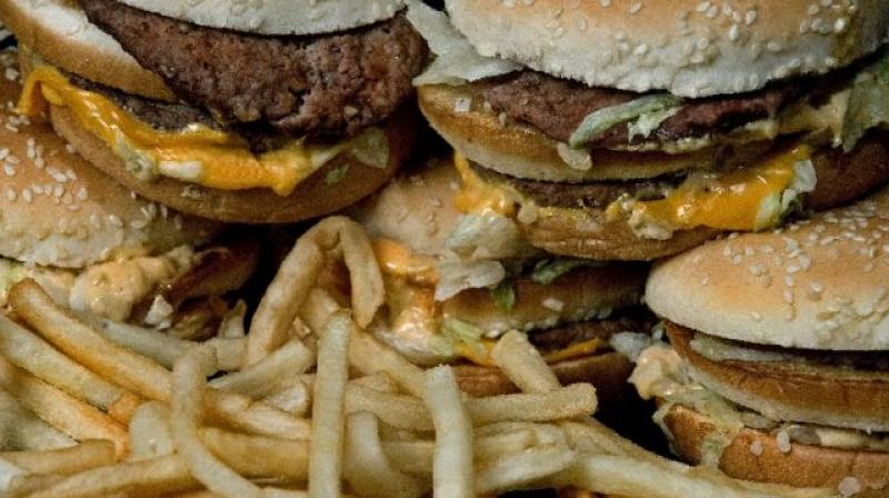 Being on a limited budget may result in having to rely on cheaper, high-calorie foods that contribute to weight gain and the risk of chronic disease, the authors write.  (Photo: AFP)