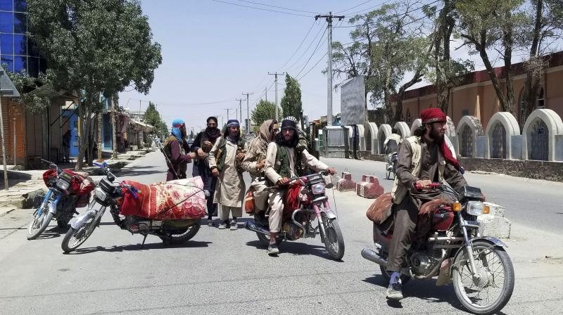 Taliban fighters patrol inside the city of Ghazni, southwest of Kabul, Afghanistan, Thursday, Aug. 12, 2021. (AP/Gulabuddin Amiri)
